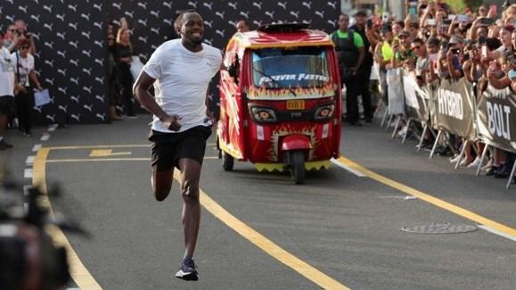 Usain Bolt en Peru competencia mototaxi