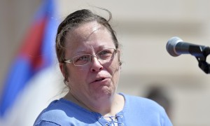 Rowan County Kentucky clerk Kim Davis shows emotion as she is cheered by a gathering of supporters during a rally on the steps of the Kentucky state capitol on Saturday. Photograph: Timothy D. Easley/AP