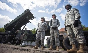 US soldiers stand in front of a Patriot missile battery at an army base in the northern Polish town of Morag, in May. Photograph: Wojtek Radwanski/AFP/Getty Images