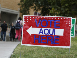 A sign shows the way to a polling station in Austin, Texas. A federal appeals court has knocked down a state voter ID law. Erich Schlegel/Getty Images