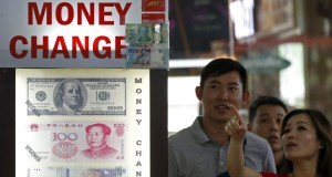 China Sells Major Part of US Gov't Bonds to Back Up Yuan. Image: Reuters/Edgar Su
