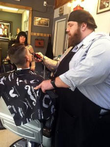 John Interval cuts a client's hair at his barbershop, Barbiere. OBSERVER-REPORTER/KAREN MANSFIELD