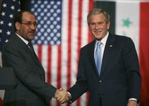 Iraq's Prime Minister Nuri al-Maliki (L) shakes hands with U.S. President George W. Bush in Amman, November, 2006. ALI JAREKJI / REUTERS