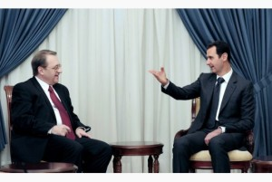In a photo provided by the state-run Syrian Arab News Agency, President Bashar Assad of Syria meets with Mikhail Bogdanov, left, a Russian deputy foreign minister, in Damascus, Dec. 10, 2014. Russia has sent an advance military team to Syria and taken other steps that some fear could presage a vast expansion of Russian support for Assad. Photo: SANA / NYT
