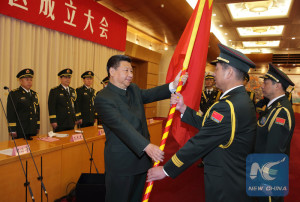 Chinese President Xi Jinping (L, front), also general secretary of the Communist Party of China (CPC) Central Committee and chairman of the Central Military Commission, confers a military flag to Commander Zhao Zongqi and Political Commissar Zhu Fuxi of the Western Theater Command in Beijing, capital of China, Feb. 1, 2016. Xi on Monday conferred military flags on the five newly-established theater commands of the People's Liberation Army (PLA). (Xinhua/Li Gang)