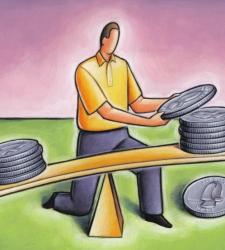 Man balancing stacks of coins