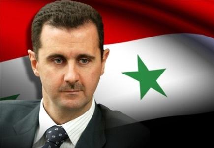 20131204-bashar-assad-y-bandera-siria.jpg