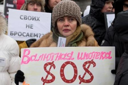 20150112-russia_a-protester-holds-a-banner-reading.jpg